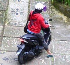 Kadek on motorbike in Ubud, Bali