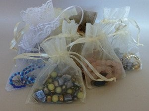 Jewelry travels safely in organza bags