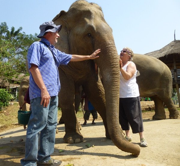 Neil and Laurie up close and personal with an elephant