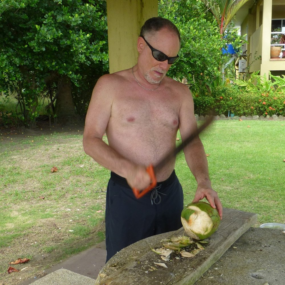 cutting open a young coconut in Costa Rica