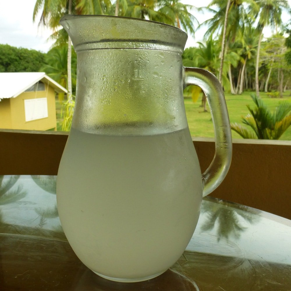 pitcher of agua de pipa young coconut water